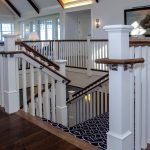 Photo of a commercial stair with box newels, wood balusters, and and ADA compliant handrail.
