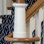 Close-up photo of a custom newel post in the shape of a lighthouse.