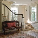 Straight L-shaped stair with wood balusters and turned newel post.