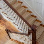 Straight scissor stair with box newels and wood balusters.