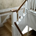 Straight stair with custom box newels and custom wood balusters.