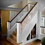 Photo of a straight stair with custom box newels and custom wood balusters.