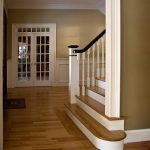 Photo of a straight stair with box newels and wood balusters.