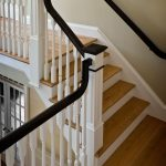 Photo taken from above of a straight stair with box newels and wood balusters.