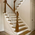 Straight scissor stair with wood balusters and turned newels.