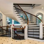 Photo of a unsupported curved stair with wrought iron balusters.