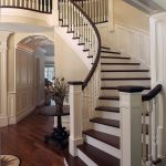 Curved stair with wood balusters and custom box newels.