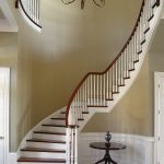 Photo of a curved stair with wood balusters.