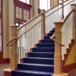 Photo of a commercial straight stair with box newels and wood balusters.