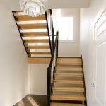 Photo of a straight scissor stair with open risers and cable railing.