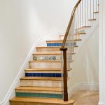 Curved staircase with tiled risers.