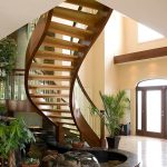 Unsupported curved staircase with open risers.