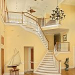 Flared stair with wood balusters and over-the-post railing.