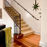 Straight stair with wrought iron balusters.
