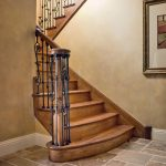 Photo of a straight scissor stair with wrought iron balusters.