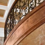 Photo of curved stair with custom wrought iron balusters.