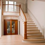 Photo of a straight flared stair with box newels and wood balusters.