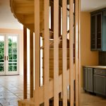 Wood spiral staircase with a unique balustrade.