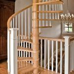 Spiral staircase with wood balusters and box newels.