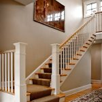 Straight stair with box newels and wood balusters.