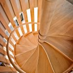 Photo taken from above of a spiral staircase.