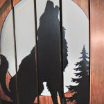 Custom carved balustrade with the image of a wolf.
