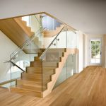 Photo of a modern scissor stair with glass railing.