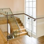 Modern scissor stair with glass railing.