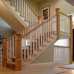 Photo of a scissor stair with box newels and wood balusters. The upper stair is unsupported.