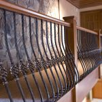 Guardrail with wrought iron balusters.
