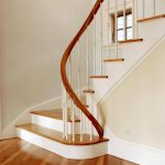 Winding staircase with a unique custom curved rail.