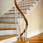 Photo of a winding staircase with a unique custom curved rail.