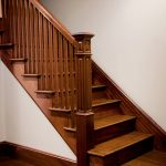 Photo of a straight stair with a box newel and wood balusters.