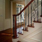 Photo of a straight stair with wrought iron balusters.