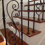 Close-up photo of wrought iron balusters.