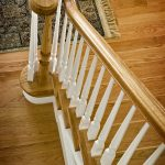 Photo taken from above of an over-the-post stair with wood balusters.