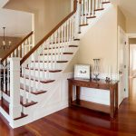L-shaped stair with box newels and wood balusters.