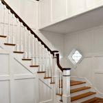 Photo of a L-shaped stair with box newels and wood balusters. Stair features wood balusters.