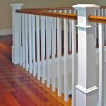 Photo of a guardrail with wood balusters and box newels posts.