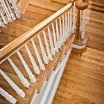 Over-the-post stair with wood balusters.