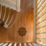 Photo taken from above of a flared stair.