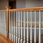 Photo of a guardrail with wood balusters and box newels.