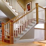 Unsupported straight stair with box newels and wood balusters.