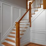 Straight L-shaped stair with box newels and wood balusters.