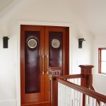 Photo of a guardrail with custom wood balusters and custom wood box newel posts.