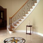 Curved stair with wrought iron balusters.