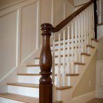 Photo of a stair with a custom legacy newel post and wood balusters.