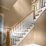 Photo of a L-shaped straight stair with box newels and wood balusters.