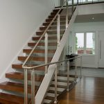 Photo of a modern stair with glass railing and open risers.