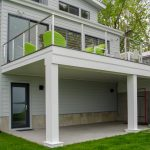 Exterior photo of a deck with cable railing on a coastal home.
